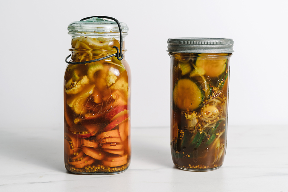 Two jars of pickle vegetables
