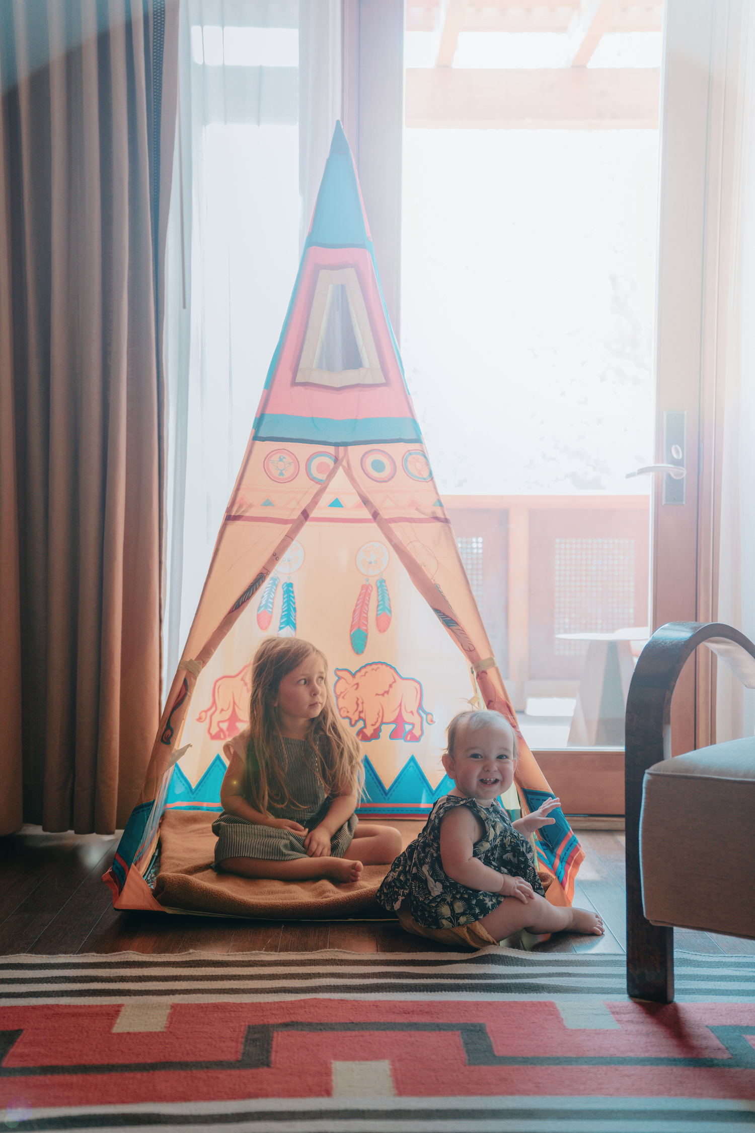 Children in a teepee