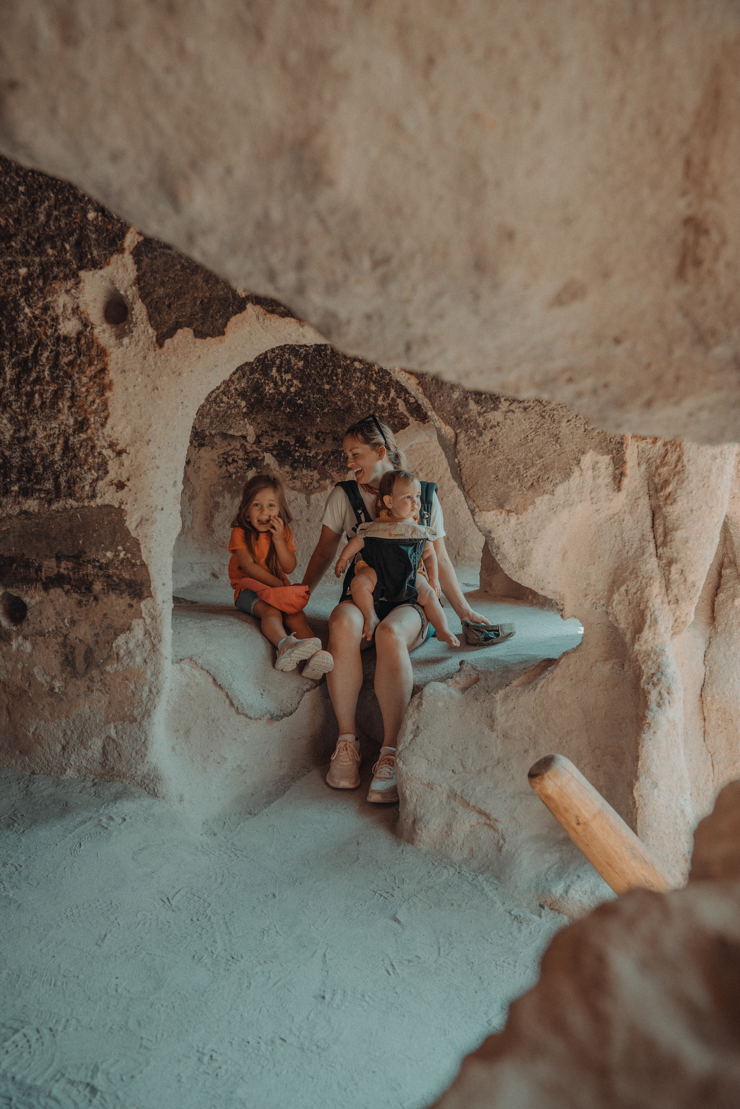 Three people in a Santa Fe cave