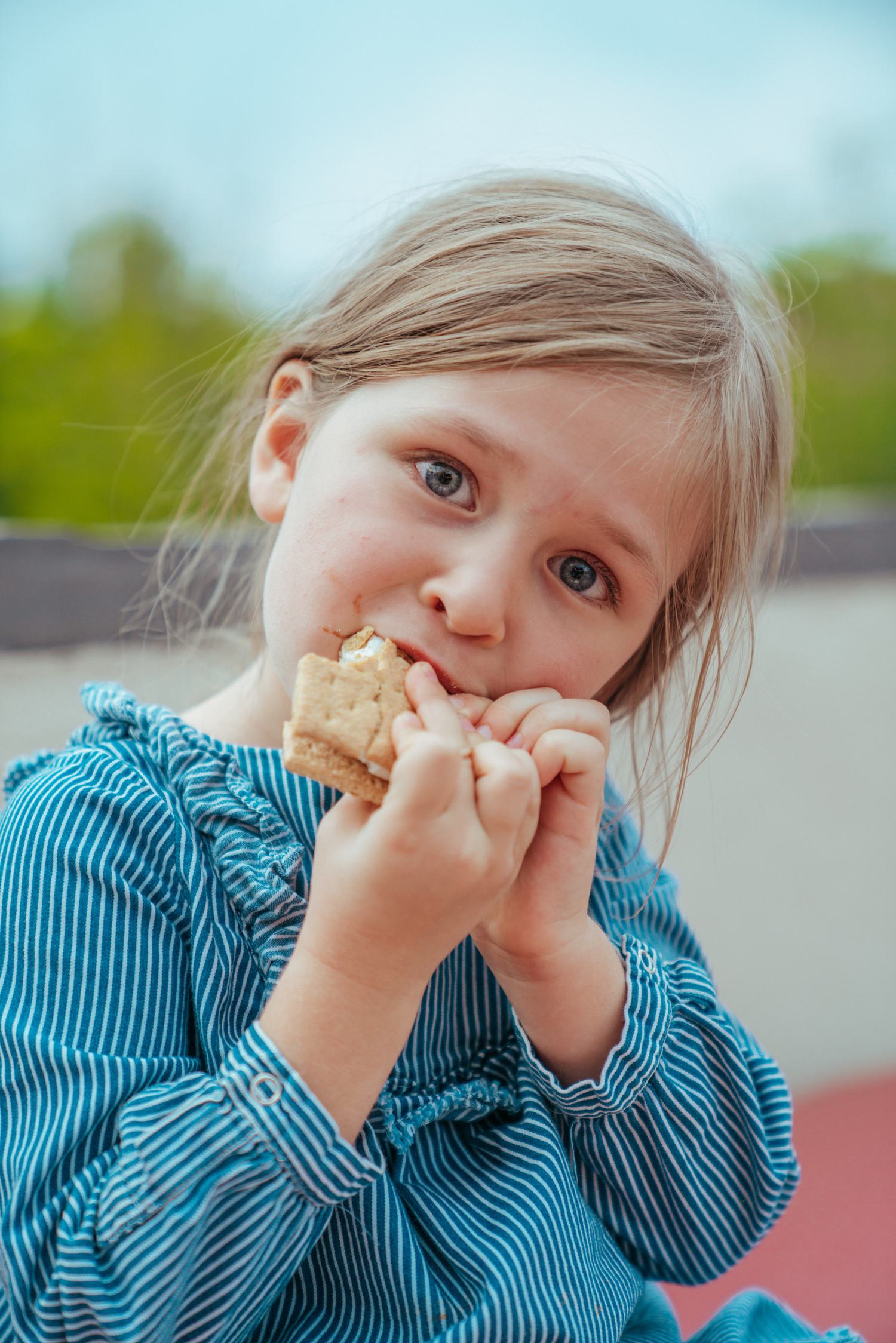 A little girl eating smores