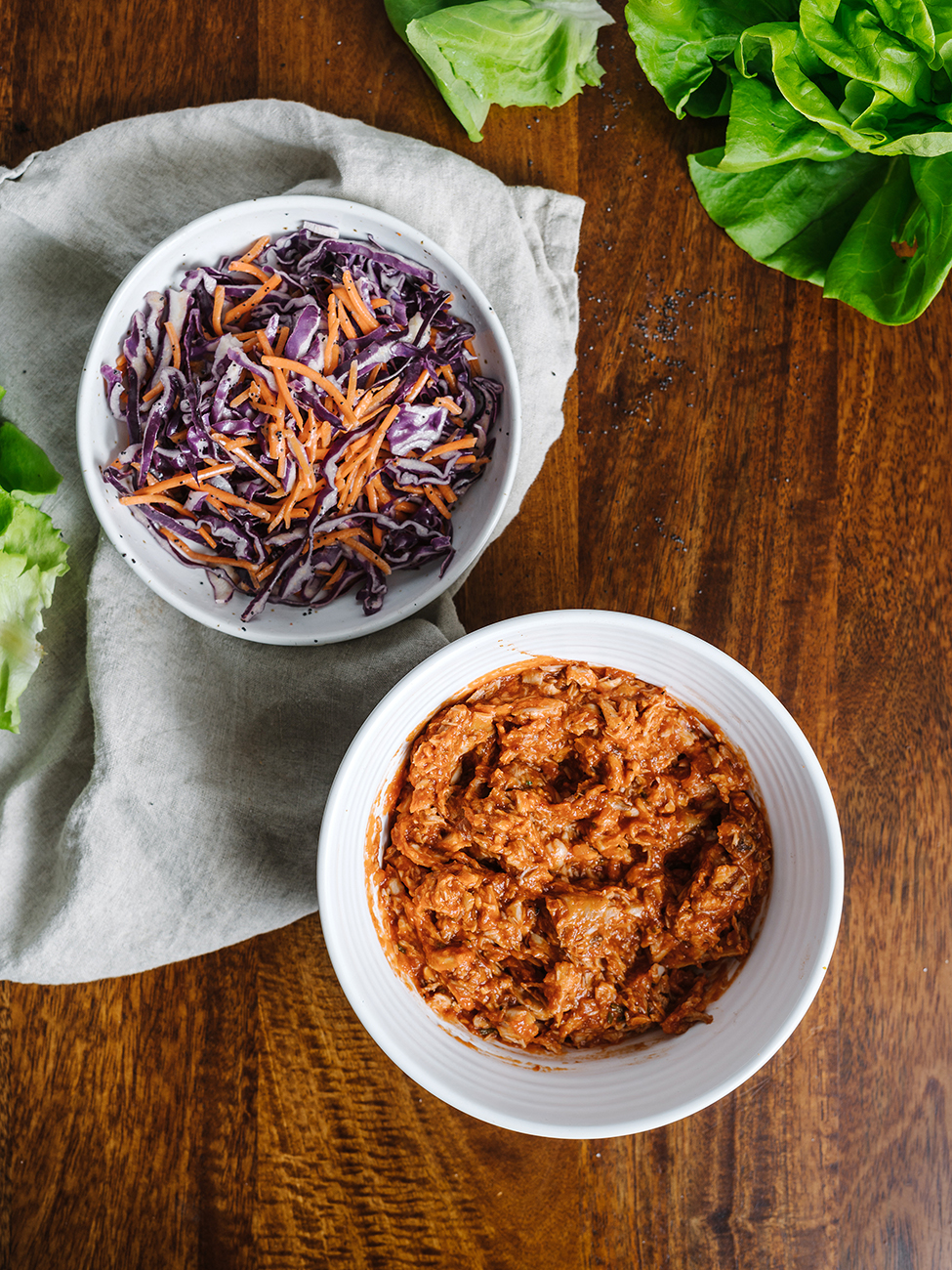 bowl of bbq pulled chicken and bowl of slaw