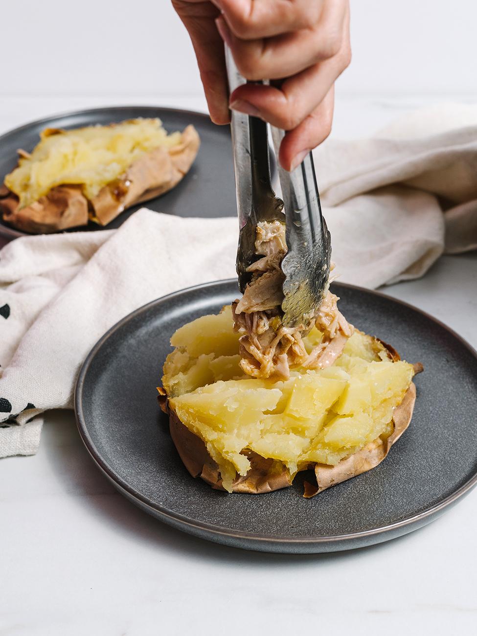 placing pork onto potato