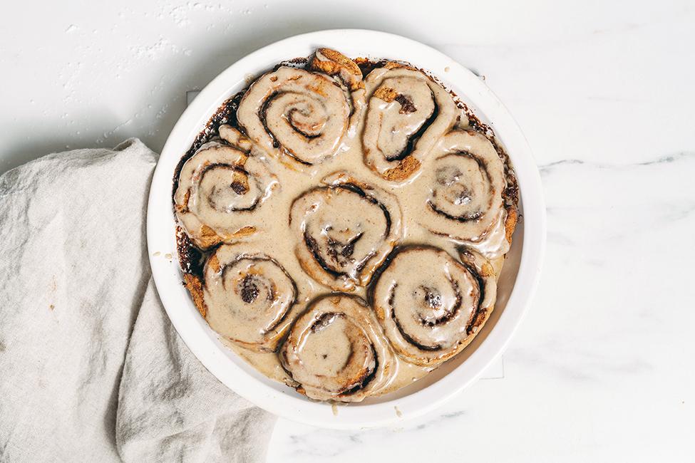 Pumpkin Spice Cinnamon Rolls in a round baking dish