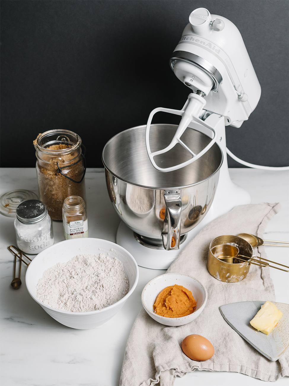 Ingredients and a mixer to make Pumpkin Spice Cinnamon Rolls