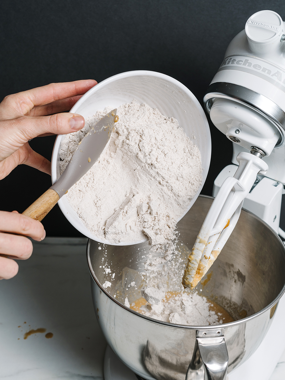 Flour being tipped into the mixer