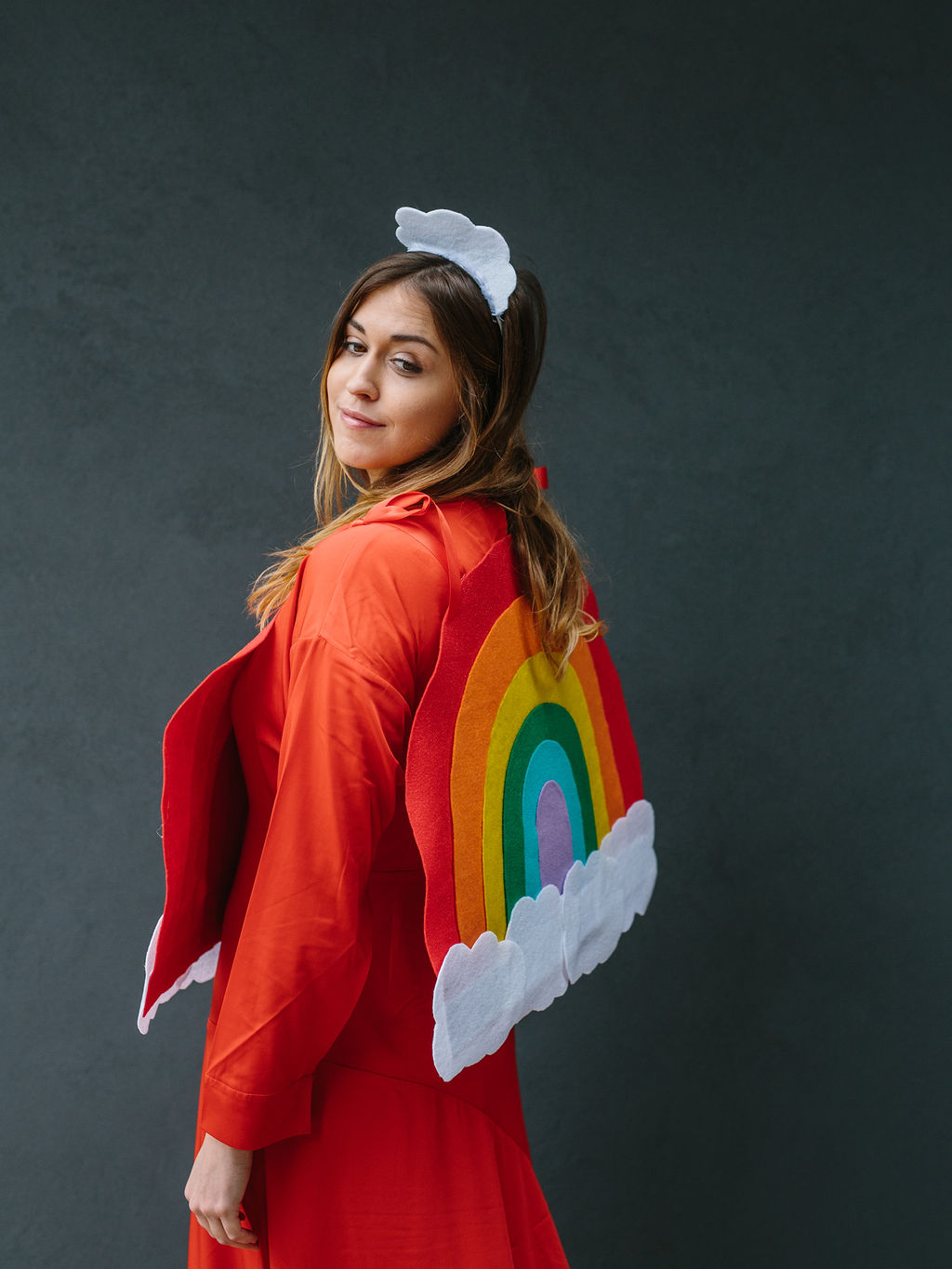 Showing the back of the rainbow costume