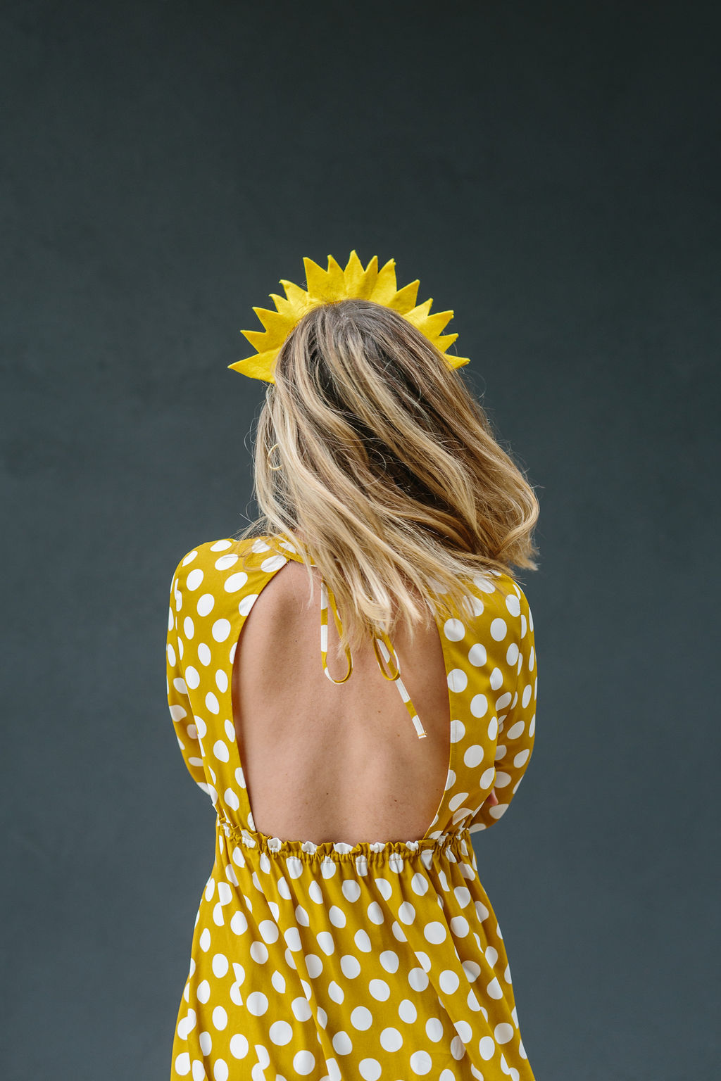 Showing the back of the dress for the sun costume
