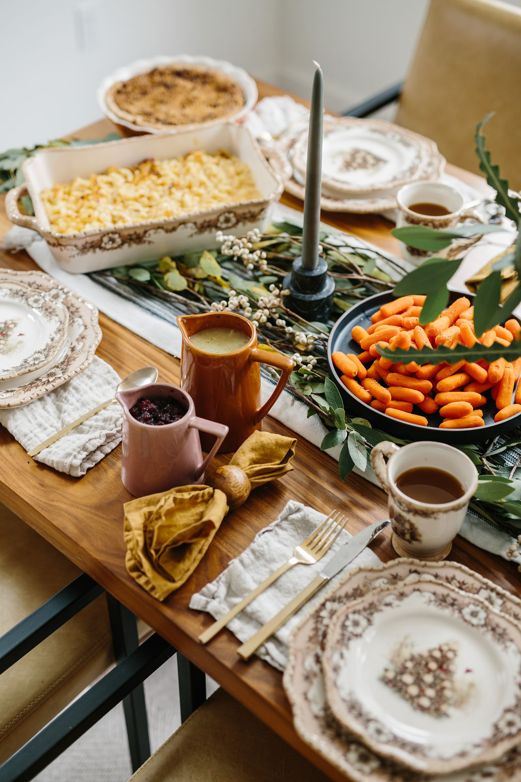 A friendsgiving table set ready for guests