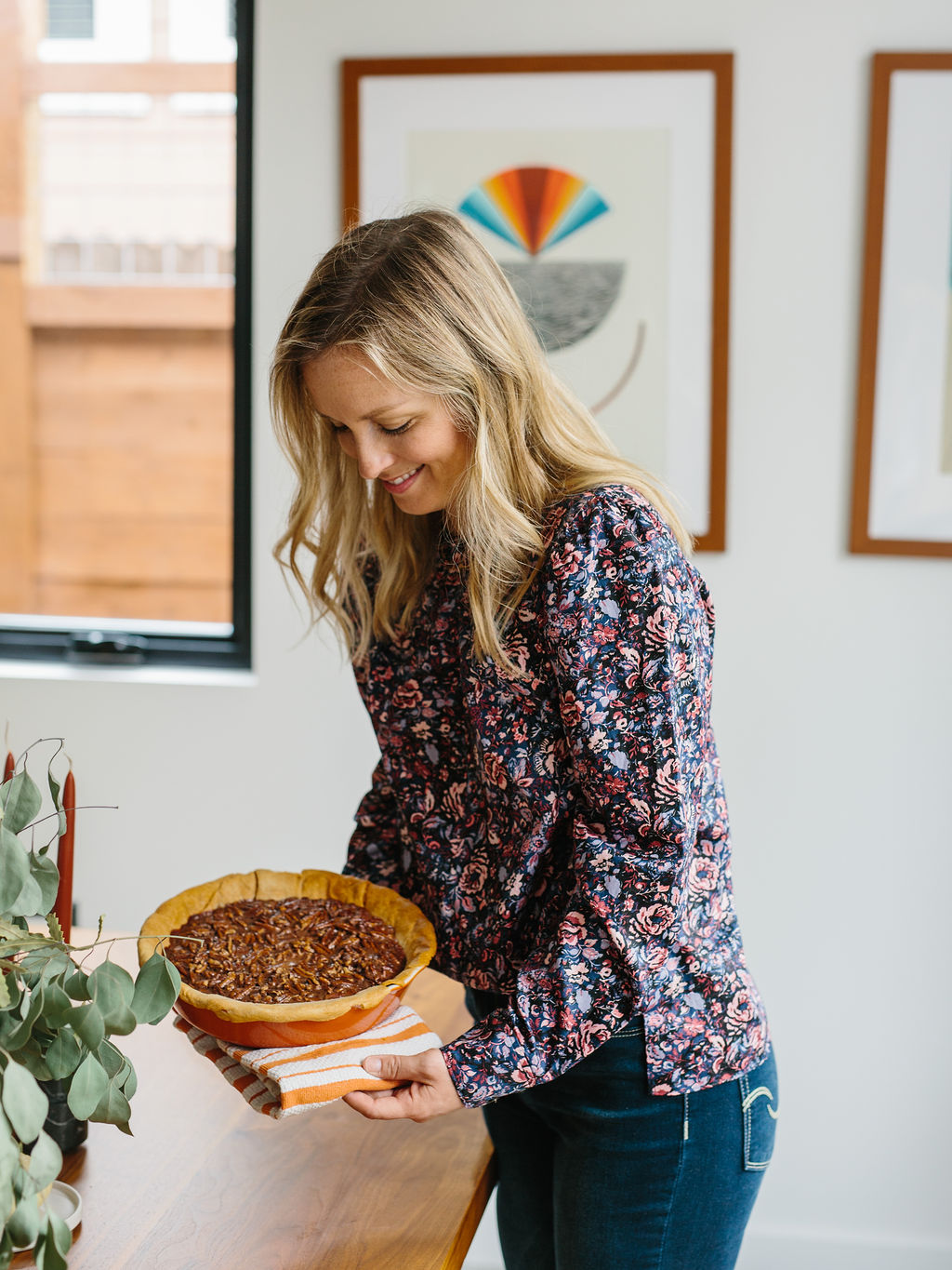Placing the bourbon and chocolate pecan pie on a table