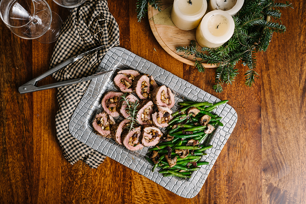 Stuffed Pork Tenderloin on a large plate ready to serve