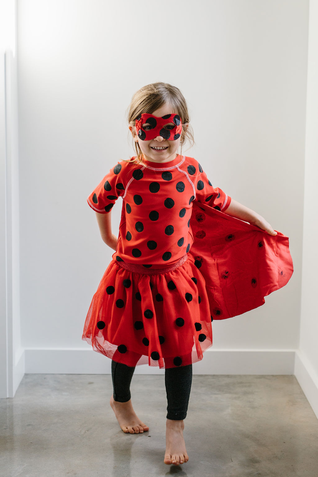 A child in a miraculous ladybug costume