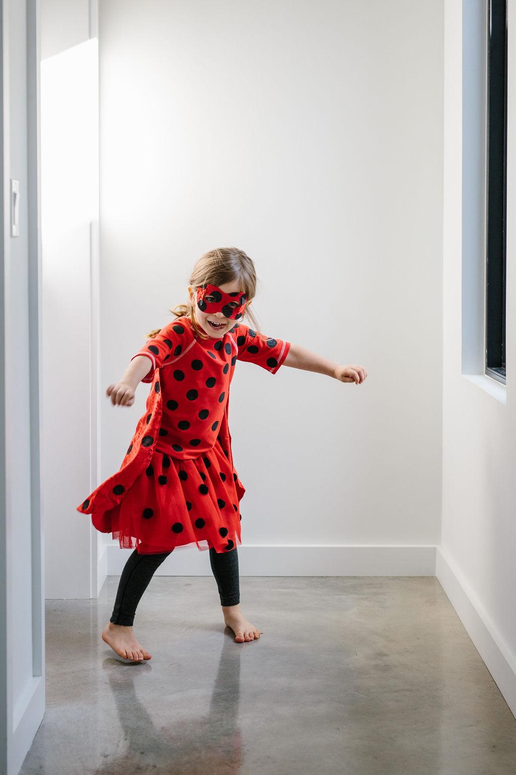 A child playing dress up