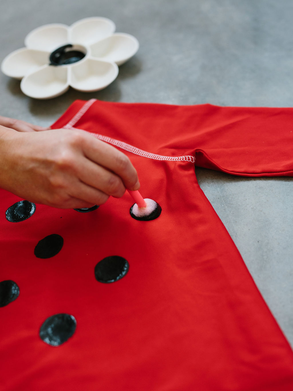 Placing dots on the miraculous ladybug costume