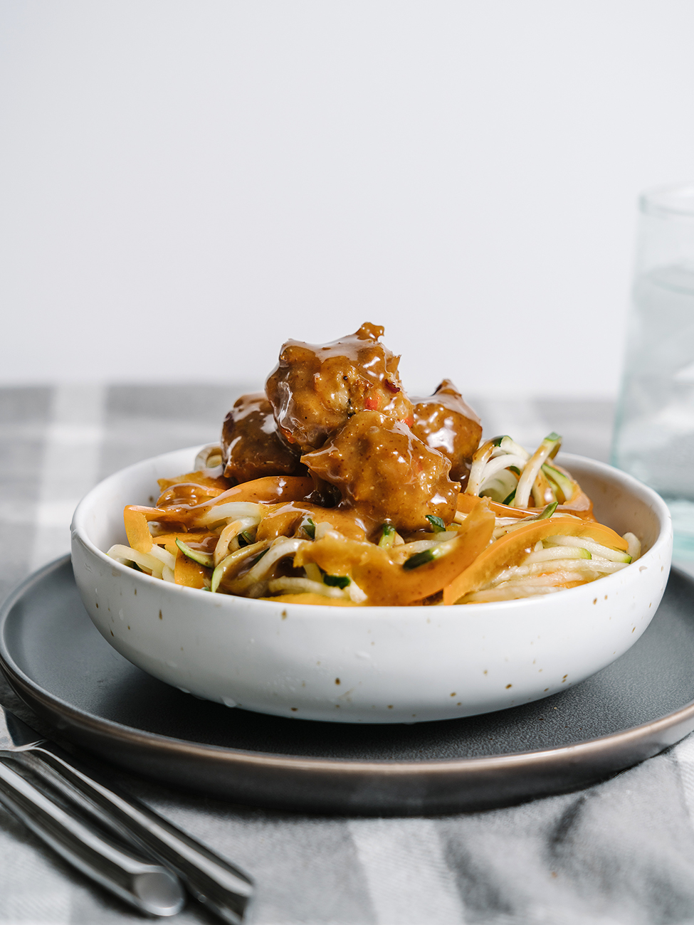Chicken Teriyaki Meatballs served on top of noodles