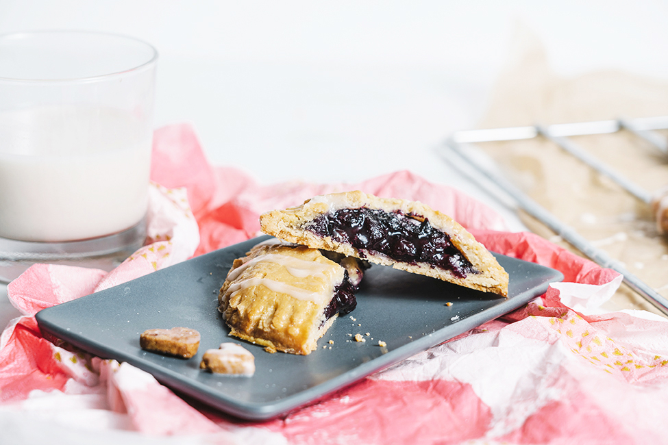 A blueberry hand pie cut in half