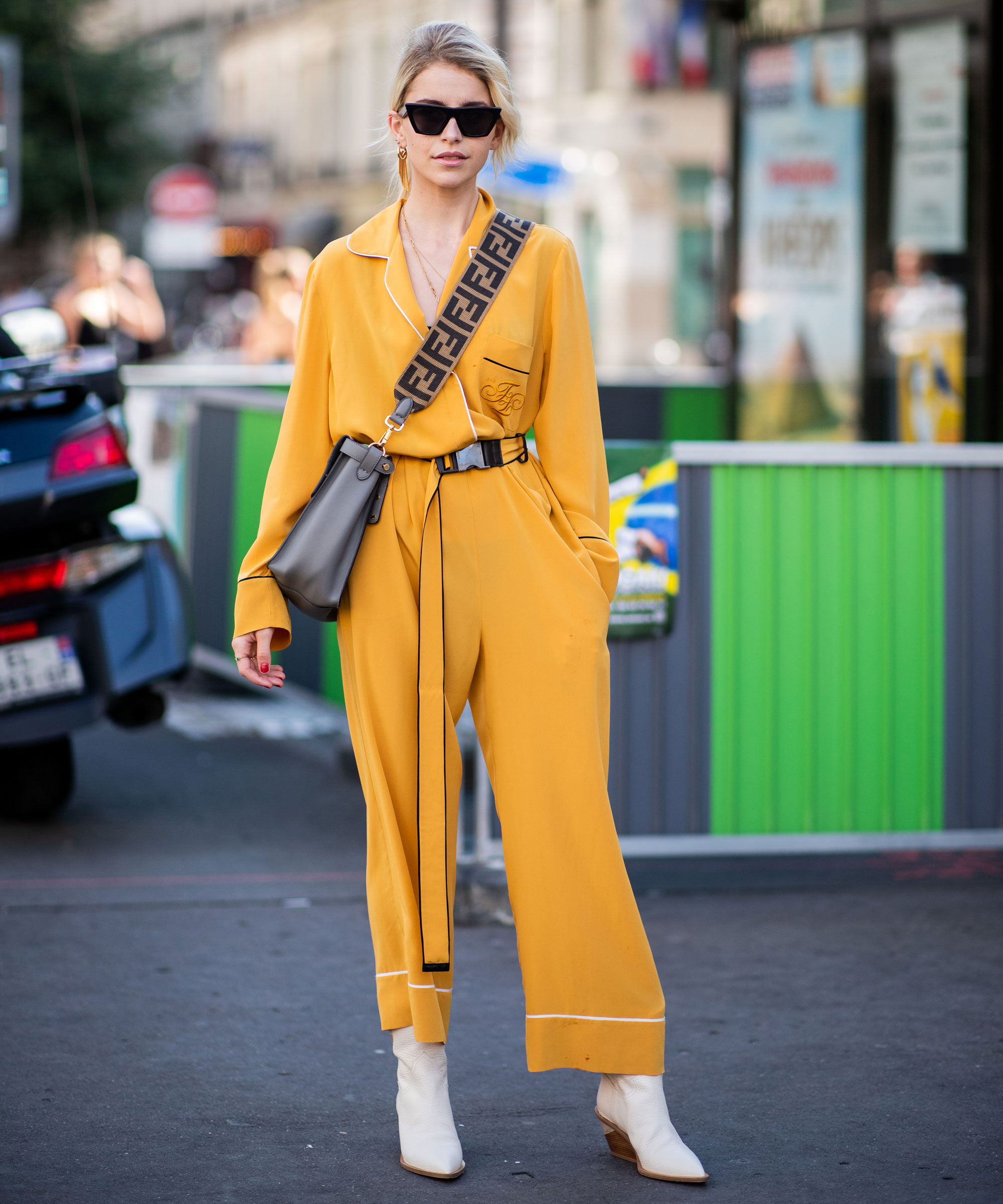 A woman wearing a yellow jumpsuit