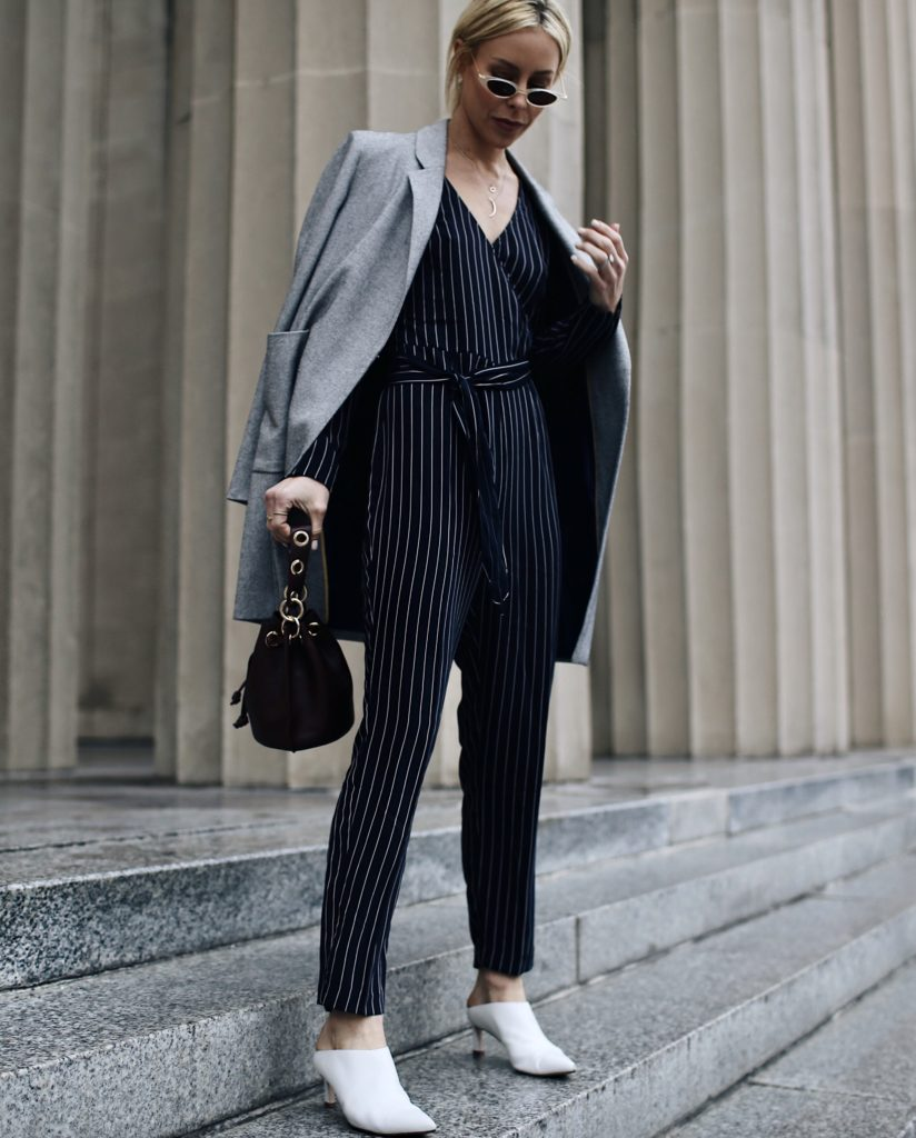 A woman wearing a pin striped jumpsuit