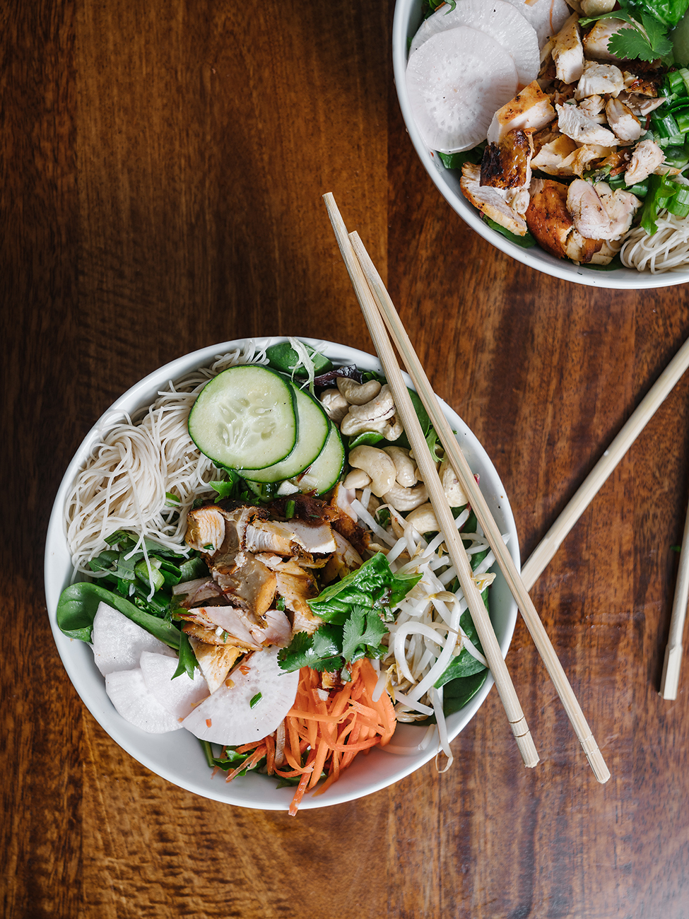 A Vietnamese noodle bowl with chopsticks
