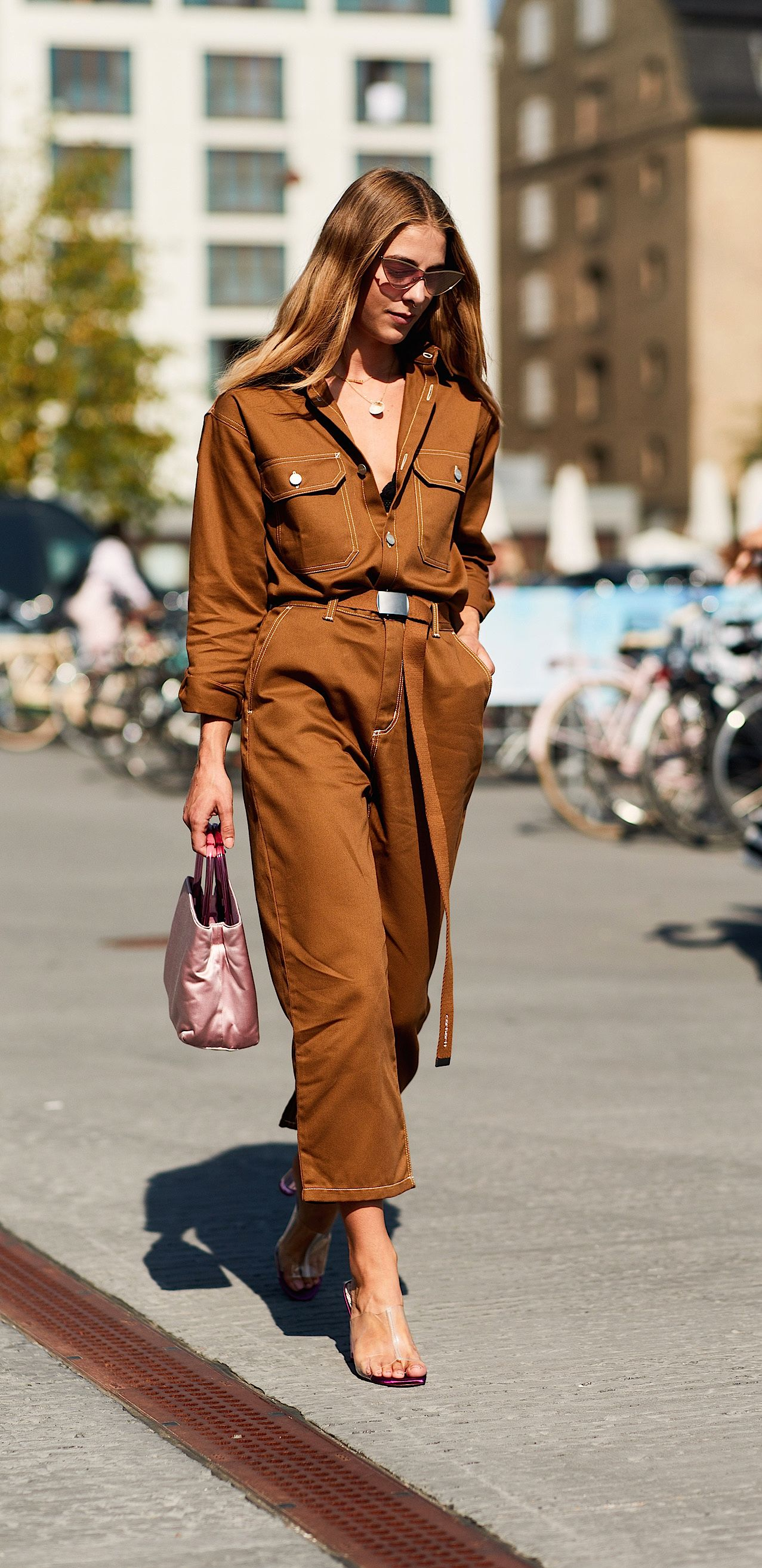 A woman wearing a brown jumpsuit
