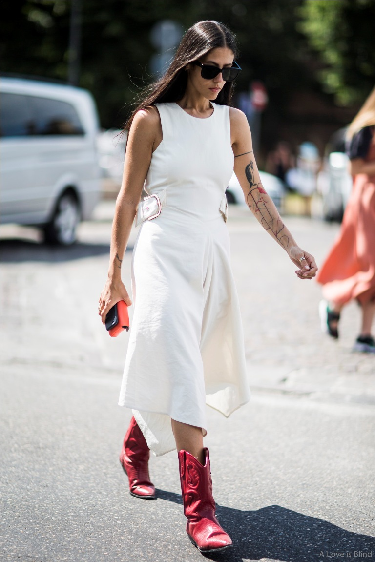 model wearing red boots and white dress