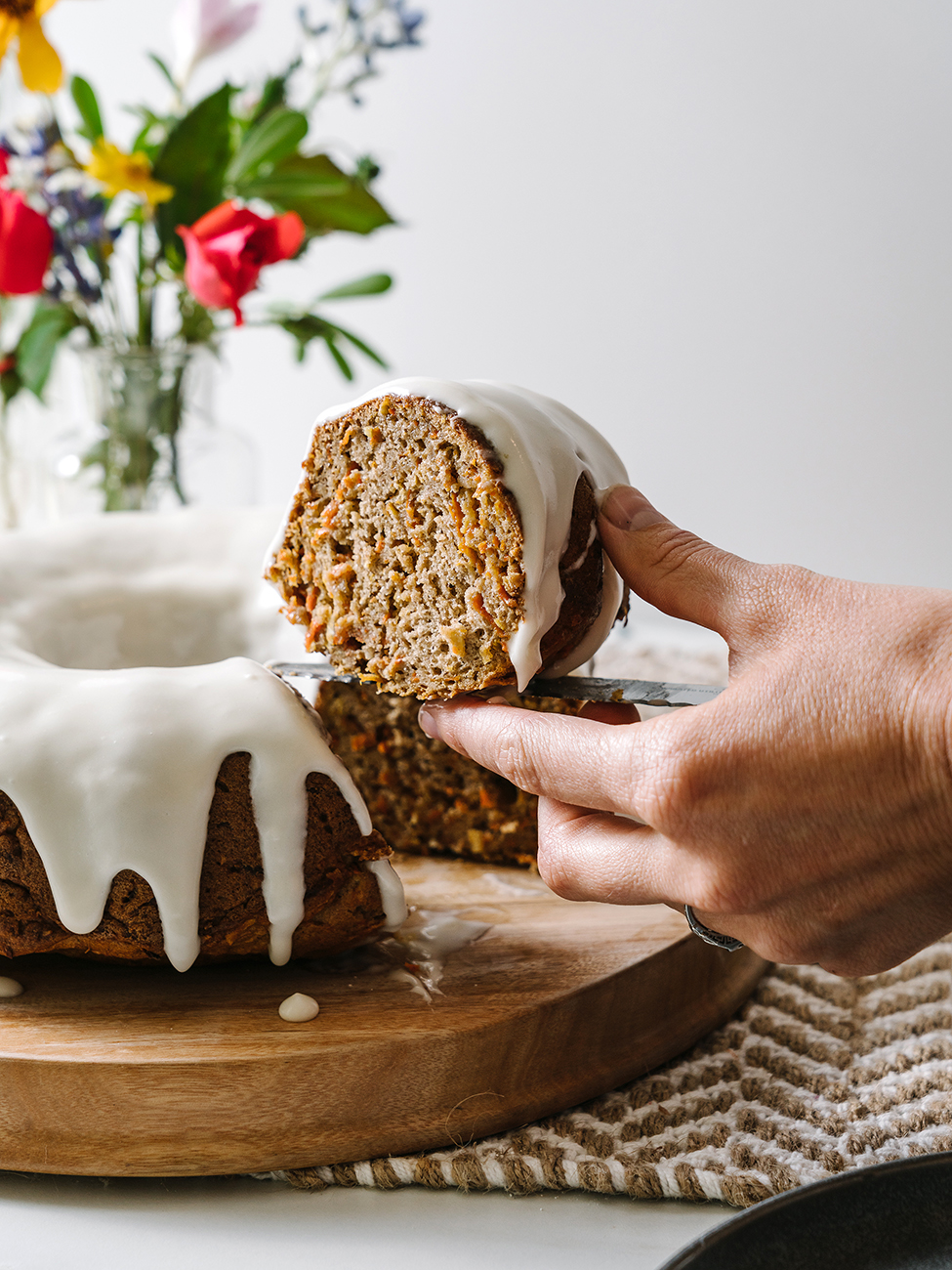 A slice of Carrot Bundt Cake being picked up