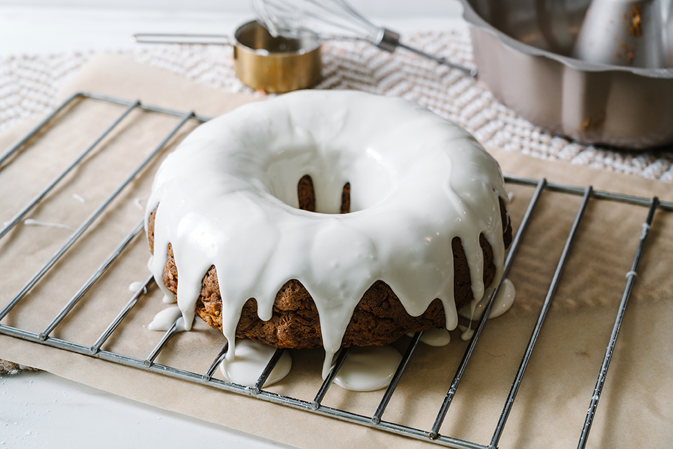 A Carrot Bundt Cake that has just been iced