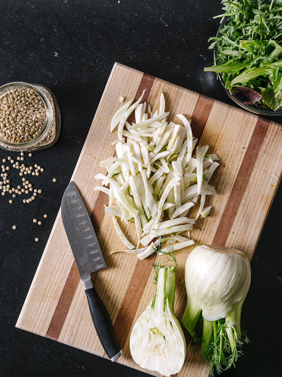 Sliced fennel on a chopping board