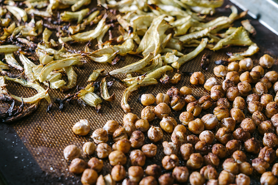 Roasted chickpeas and fennel on a baking tray