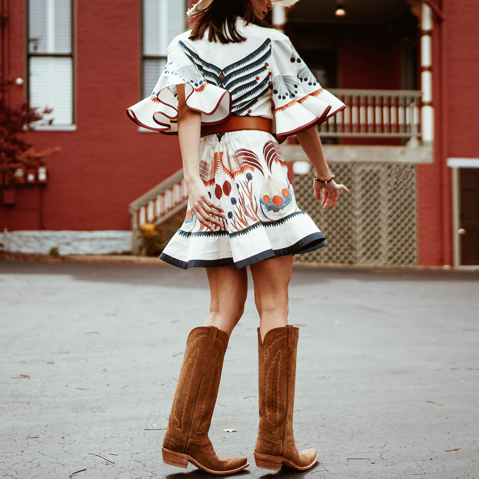 white dress and brown boots on model