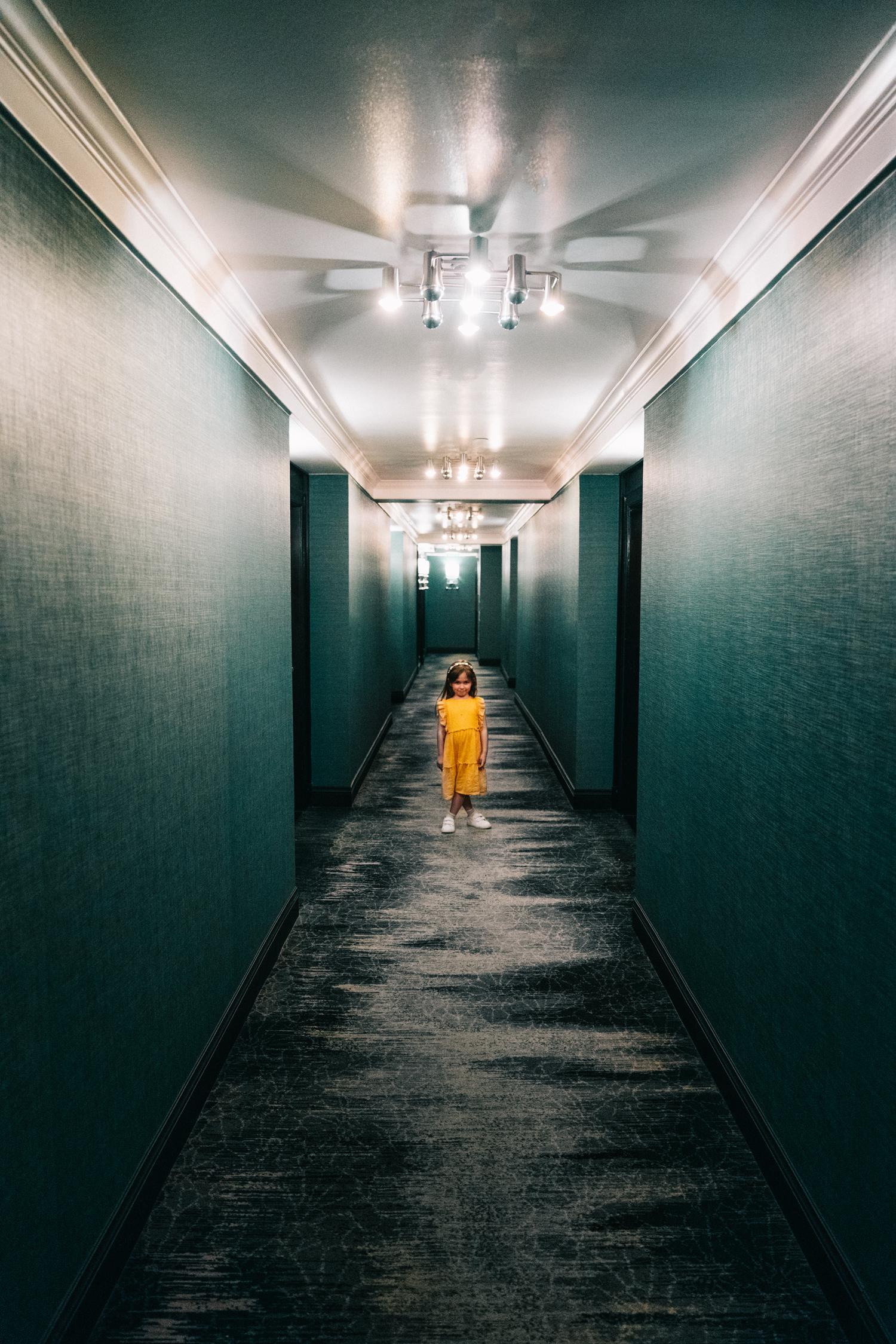 child in hotel hallway