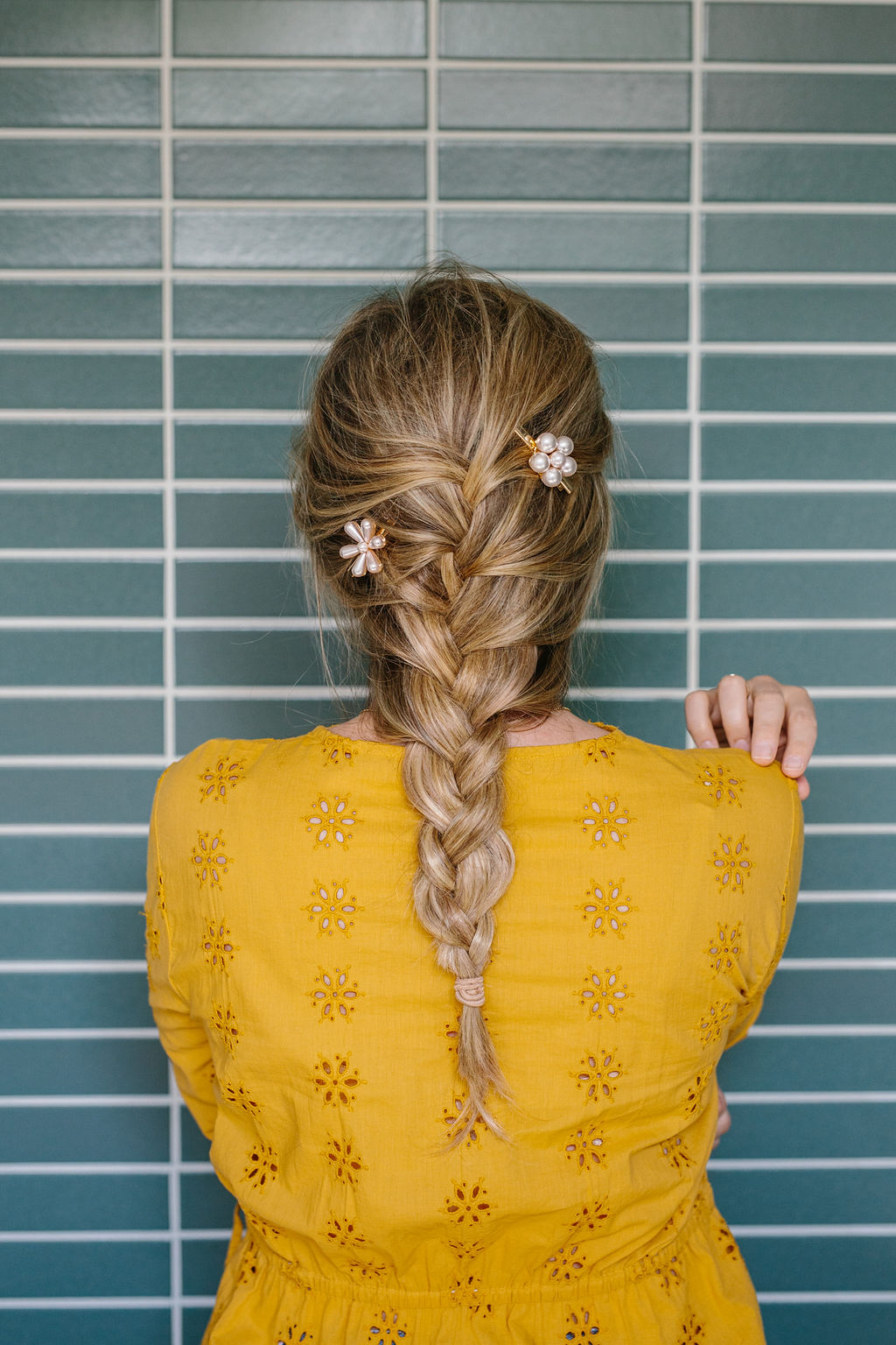 Full length shot of a women in a yellow top with a french braid
