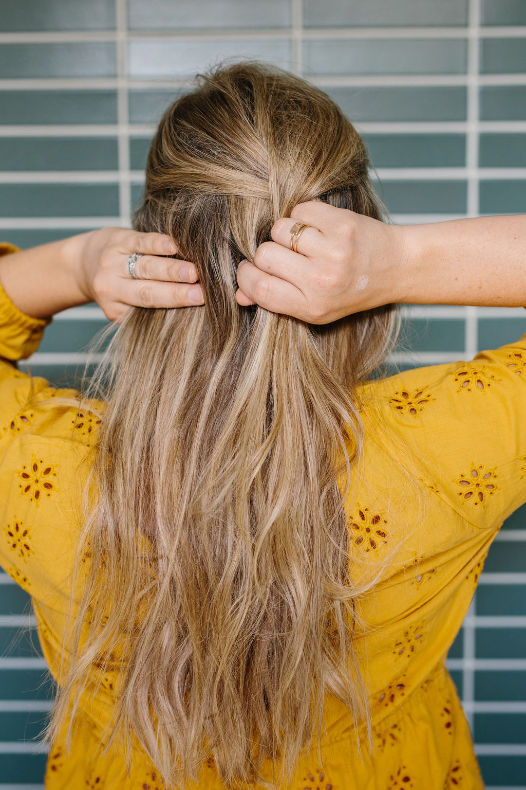 Hands separating sections of the hair