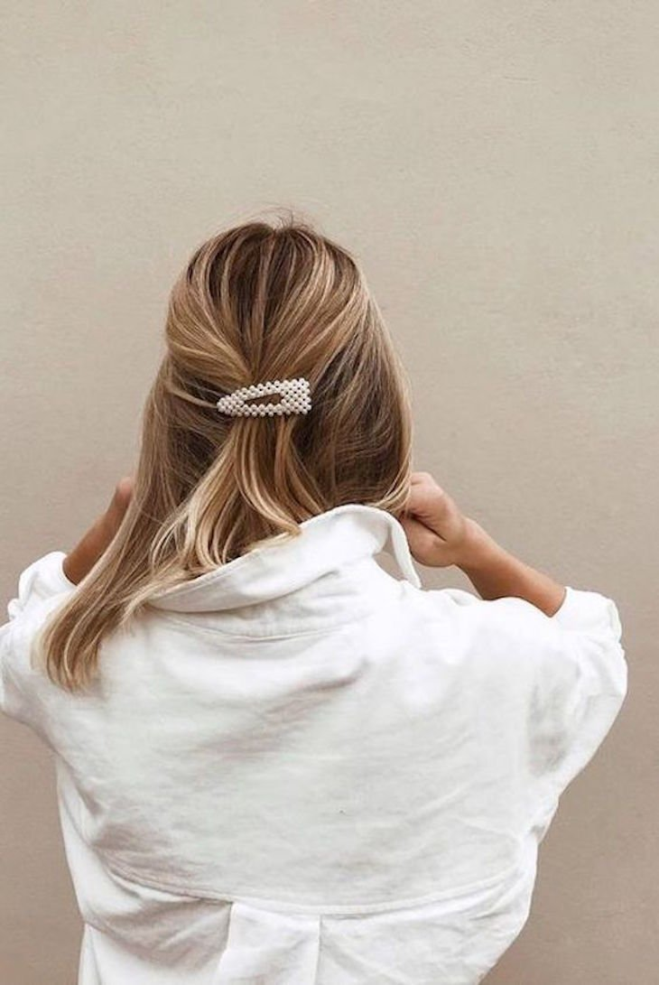 A pearl hair clip in the back of hair