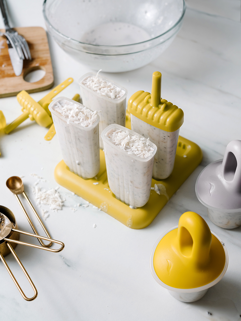 Four coconut banana popsicles in a mould