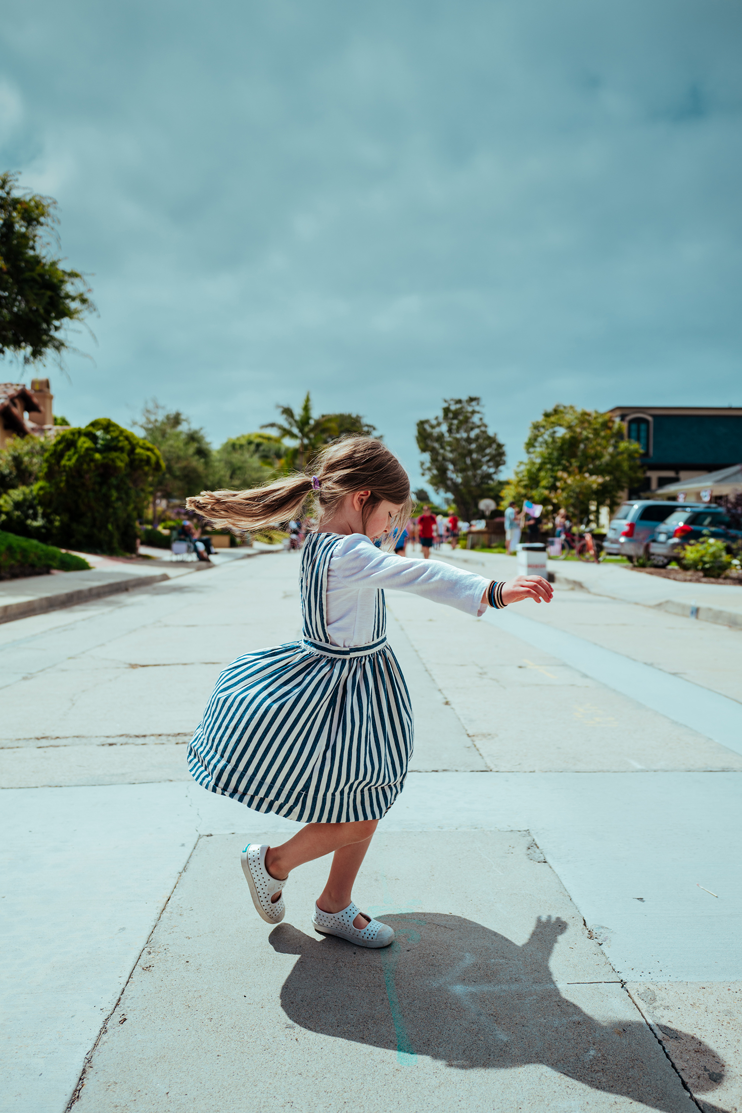 A girl playing on a san diego street