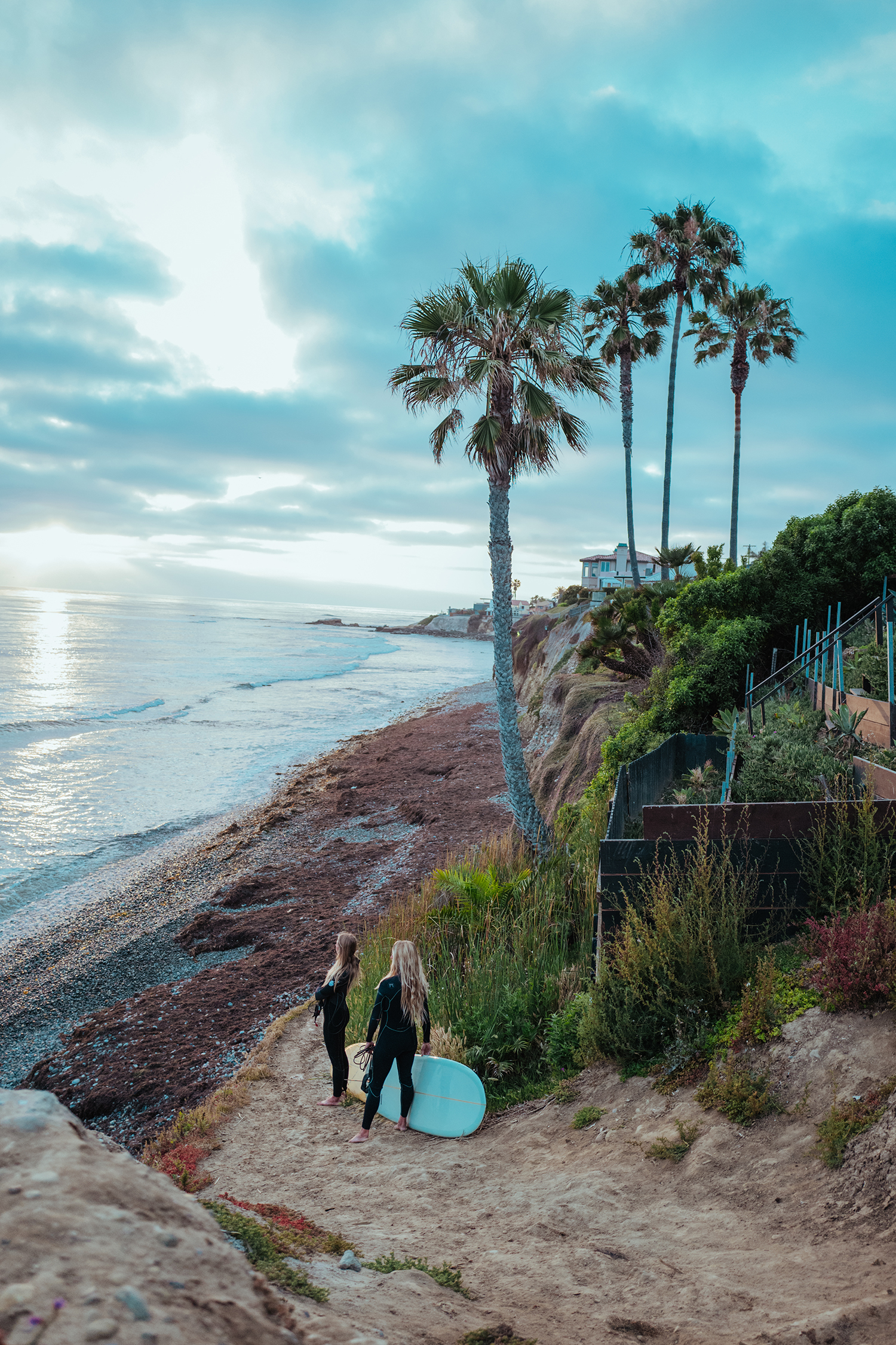 Beach in san diego with two people with surf boards