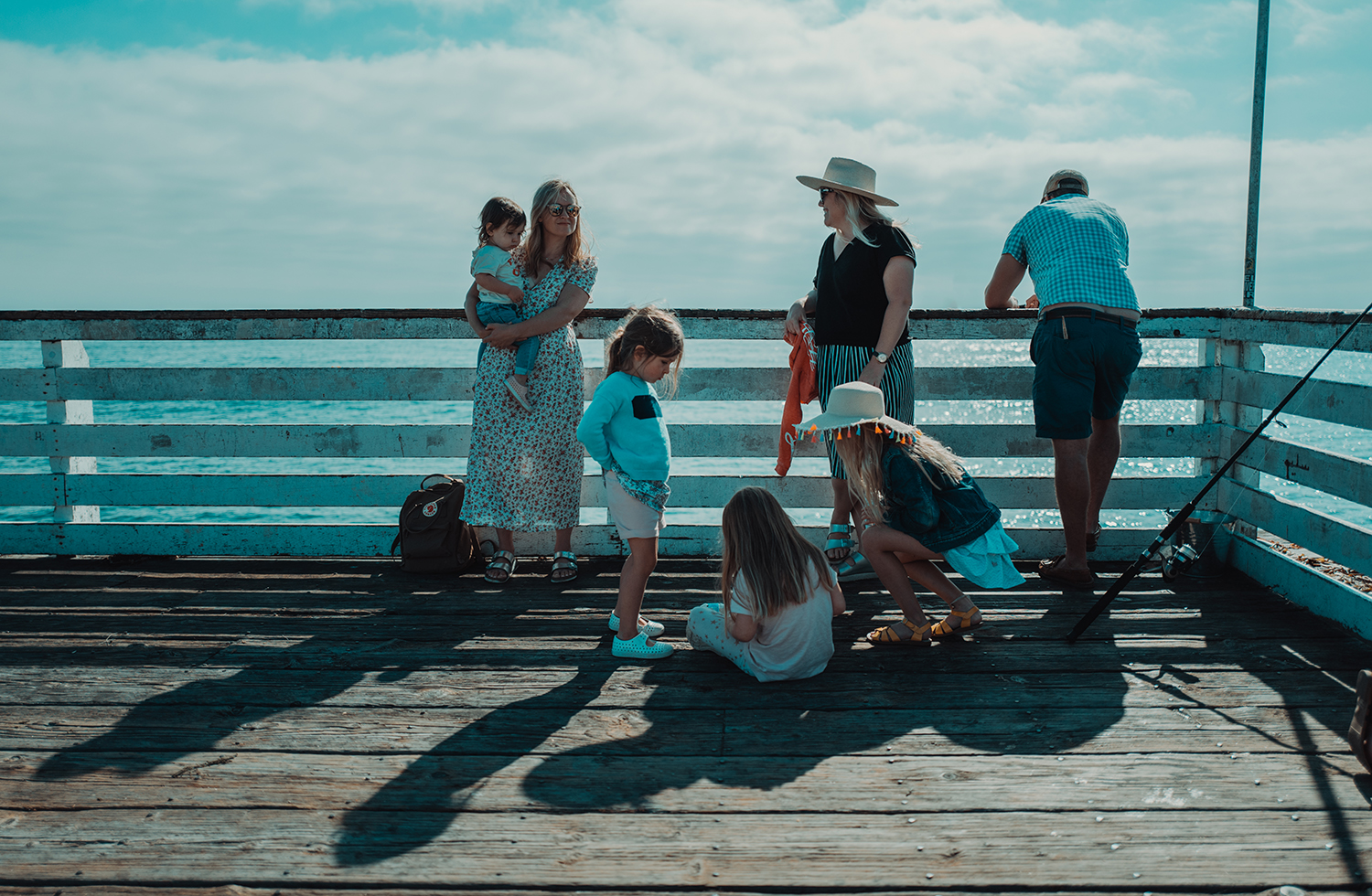 A family on a board walk