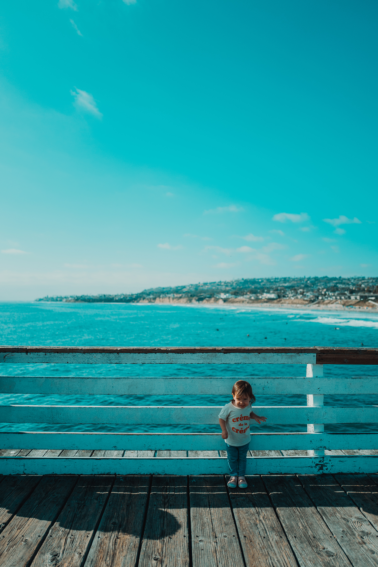 A kid on the pier