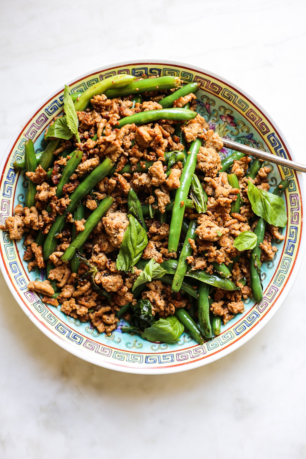 Green bean stir fry on a patterned plate