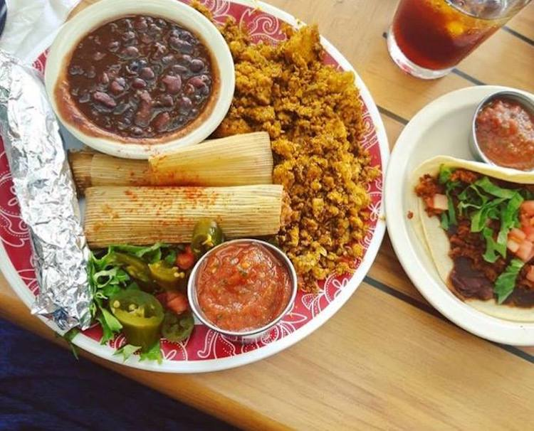 salsa and tamales on plate